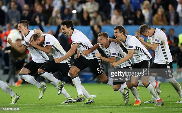 Julian Draxler Benedikt Hoewedes Mats Hummels Joshua Kimmich Thomas Mueller Bastian Schweinsteiger of Germany celebrate the victory following the...