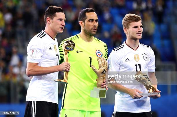 Julian Draxler Claudio Bravo and Timo Werner pose with their individual trophies following the FIFA Confederations Cup Russia 2017 Final match...