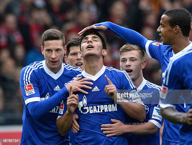 Julian Draxler KlaasJan Huntelaar Kaan Ayhan Maximilian Meyer and Joel Matip celebrate the opening goal of Ayhan during the Bundesliga match between...