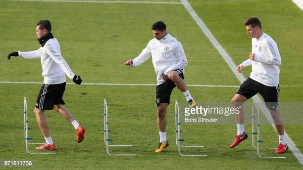 Julian Draxler Lars Stindl and Niklas Suele of Germany pratice during a training session of the German National team at FriedrichLudwigJahnSportpark...