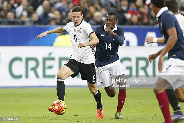 Julian Draxler of Germany and Blaise Matuidi of France in action during the international friendly match between France and Germany at Stade de...