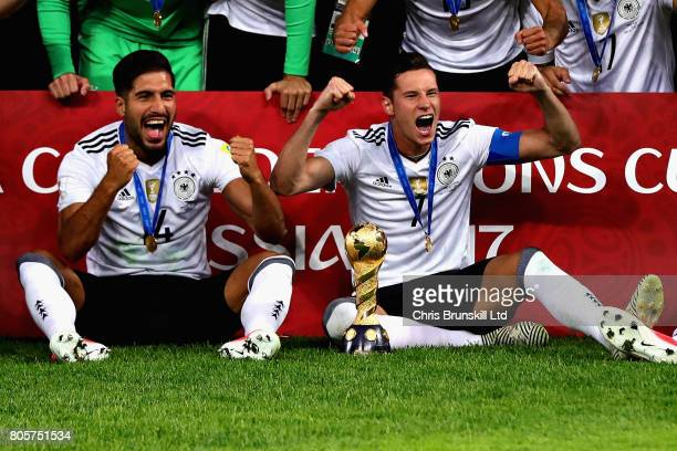 Julian Draxler of Germany and Emre Can of Germany celebrate with te trophy after the FIFA Confederations Cup Russia 2017 Final match between Chile...