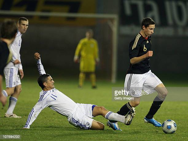 Julian Draxler of Germany and Gidi Kanyuk of Israel battle for the ball during the U18 international friendly match between Israel and Germany on...