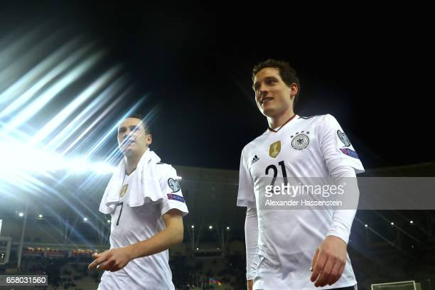 Julian Draxler of Germany and his team mate Niklas Suele look on after the FIFA 2018 World Cup Qualifing Group C between Azerbaijan and Germany at...
