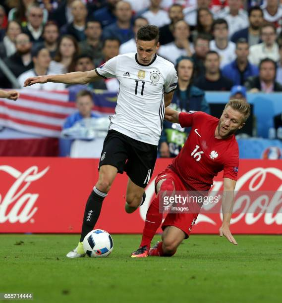 Julian Draxler of Germany and Jakub Blaszczykowski of Poland battle for the ball during the UEFA EURO 2016 Group C match between Germany and Poland...