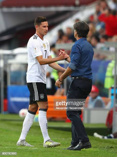 Julian Draxler of Germany and Joachim Loew coach of Germany embrace after he is subbed during the FIFA Confederations Cup Russia 2017 Group B match...