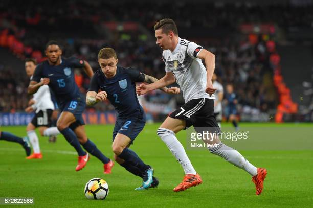 Julian Draxler of Germany and Kieran Trippier of England battle for possession during the International friendly match between England and Germany at...