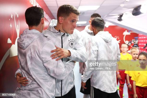 Julian Draxler of Germany and Matthias Ginter of Germany embrace in the tunnel prior to the FIFA Confederations Cup Russia 2017 Group B match between...