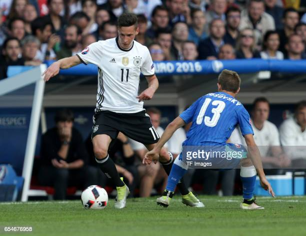 Julian Draxler of Germany and Patrik Hrosovsky of Slovakia battle for the ball during the UEFA EURO 2016 round of 16 match between Germany and...