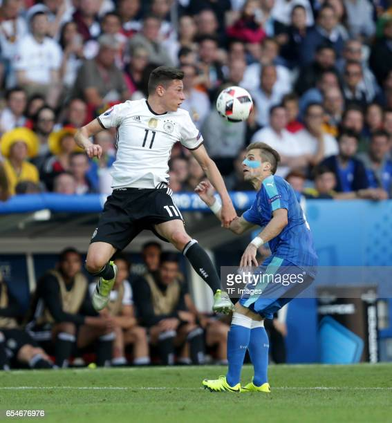 Julian Draxler of Germany and Peter Pekarik of Slovakia battle for the ball during the UEFA EURO 2016 round of 16 match between Germany and Slovakia...