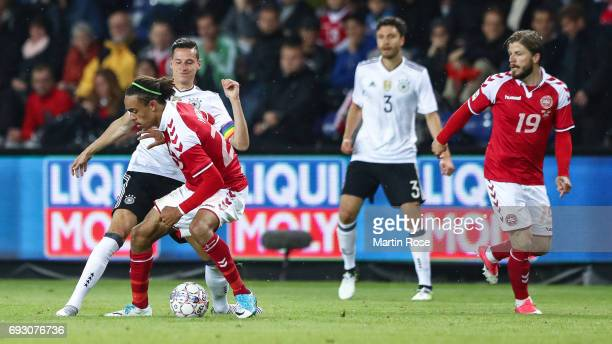 Julian Draxler of Germany and Yussuf Yurary Poulsen of Denmark battle for the ball during the international friendly match between Denmark v Germany...