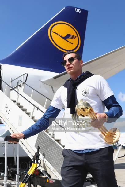 Julian Draxler of Germany arrives with his team at Frankfurt am Main International Airport on July 3 2017 in Frankfurt am Main Germany