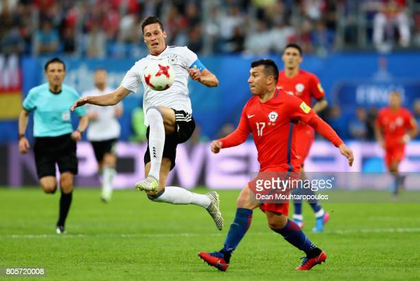 Julian Draxler of Germany attempts to control the ball in mid air while under pressure from Gary Medel of Chile during the FIFA Confederations Cup...