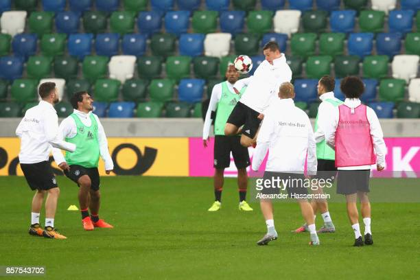 Julian Draxler of Germany battles for tha ball during a team Germany training session at Windosor Park ahead of their FIFA 2018 World Cup Group C...