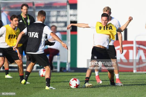 Julian Draxler of Germany battles for the ball during a team Germany training session at Park Arena training ground ahead of their FIFA...