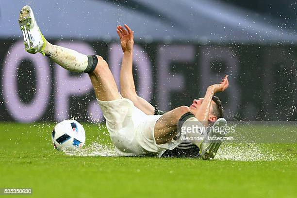 Julian Draxler of Germany battles for the ball during the international friendly match between Germany and Slovakia at WWKArena on May 29 2016 in...