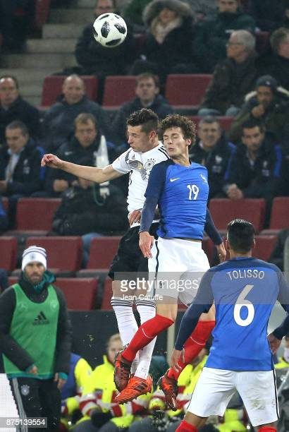 Julian Draxler of Germany Benjamin Pavard of France during the international friendly match between Germany and France at RheinEnergieStadion on...