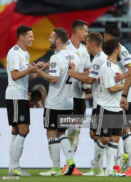 Julian Draxler of Germany celebrates his first goal with teammates during the FIFA 2018 World Cup Qualifier between Germany and San Marino at Max...