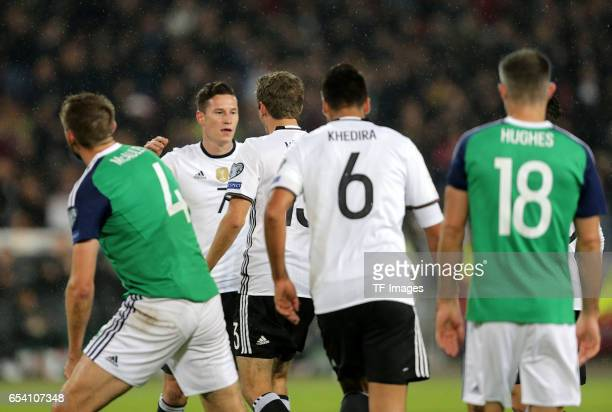 Julian Draxler of Germany celebrates his goal with teammates during the FIFA 2018 World Cup Qualifier between Germany and Northern Ireland at...