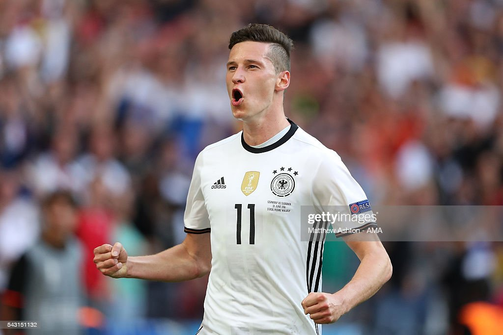 <a gi-track='captionPersonalityLinkClicked' href=/galleries/search?phrase=Julian+Draxler&family=editorial&specificpeople=7184479 ng-click='$event.stopPropagation()'>Julian Draxler</a> of Germany celebrates scoring a goal to make the score 3-0 during the UEFA Euro 2016 Round of 16 match between Germany and Slovakia at Stade Pierre-Mauroy on June 26, 2016 in Lille, France.