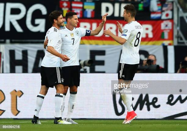 Julian Draxler of Germany celebrates scoring his sides first goal with Jonas Hector of Germany and Leon Goretzka of Germany during the FIFA 2018...