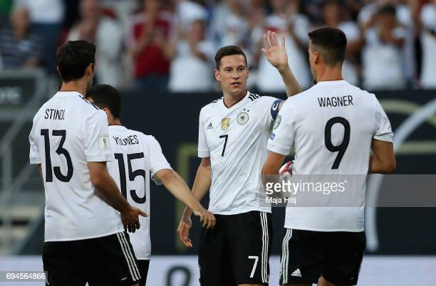 Julian Draxler of Germany celebrates scoring his sides first goal with his Germany team mates during the FIFA 2018 World Cup Qualifier between...