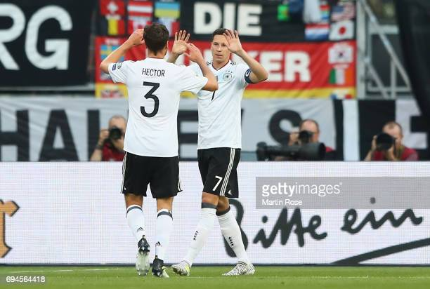 Julian Draxler of Germany celebrates scoring his sides first goal wit Jonas Hector of Germany during the FIFA 2018 World Cup Qualifier between...