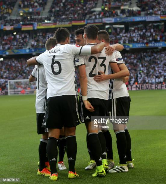 Julian Draxler of Germany celebrates scoring his team's third goal with his team mates during the UEFA EURO 2016 round of 16 match between Germany...
