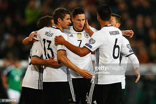 Julian Draxler of Germany celebrates with his team mates after scoring his team's first goal during the FIFA 2018 World Cup Qualifier between Germany...