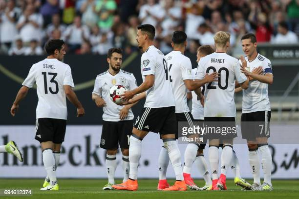 Julian Draxler of Germany celebrates with his teammates after scoring a goal to make it 10 during the FIFA 2018 World Cup Qualifier between Germany...