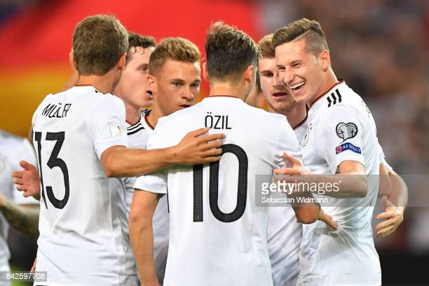 Julian Draxler of Germany celebrates with Mesut Oezil of Germany and Thomas Muellerof Germany after he scored to make it 20 during the FIFA 2018...
