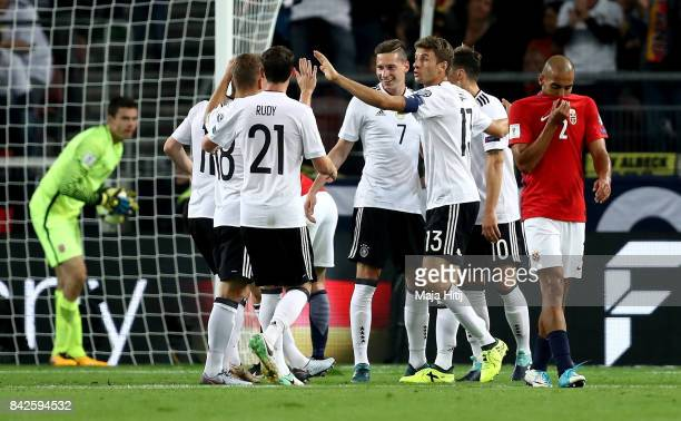 Julian Draxler of Germany celebrates with team mates after scoring his teams second goal during the FIFA 2018 World Cup Qualifier between Germany and...