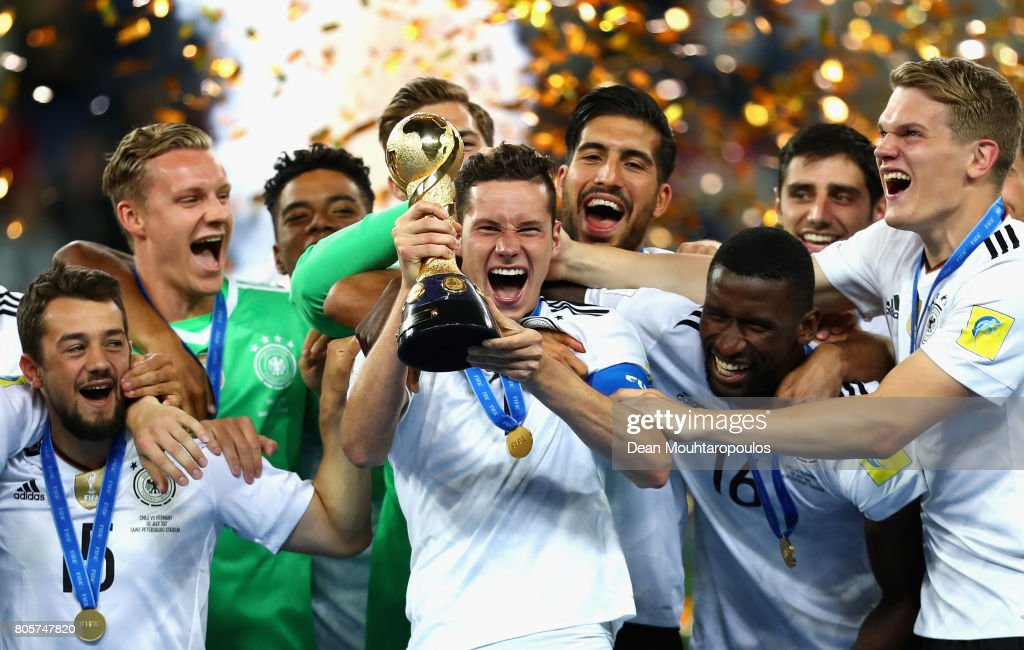 Julian Draxler of Germany celebrates with the FIFA Confederations Cup trophy after the FIFA Confederations Cup Russia 2017 Final between Chile and Germany at Saint Petersburg Stadium on July 2, 2017 in Saint Petersburg, Russia.