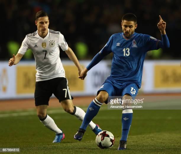 Julian Draxler of Germany challenges Dmitri Nazarov of Azerbaijan during the FIFA 2018 World Cup Qualifing Group C between Azerbaijan and Germany at...