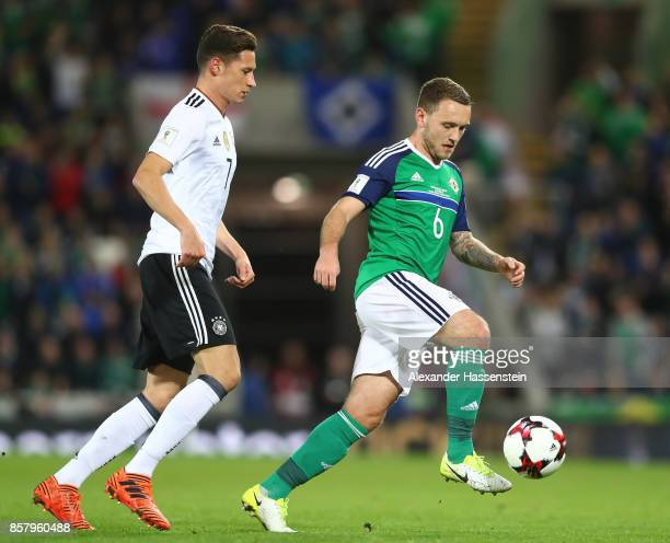 Julian Draxler of Germany challenges Lee Hodson of Northern Ireland during the FIFA 2018 World Cup Qualifier between Northern Ireland and Germany at...