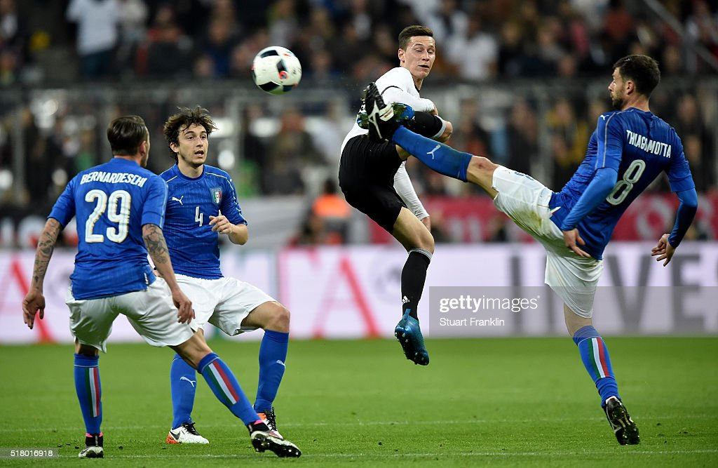 Julian Draxler of Germany challenges Thiago Motta of Italy during the International Friendly match between Germany and Italy at Allianz Arena on March 29, 2016 in Munich, Germany.