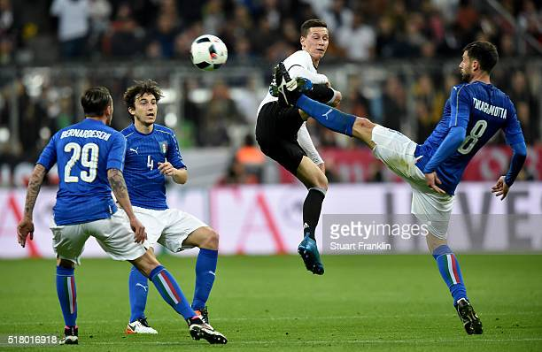 Julian Draxler of Germany challenges Thiago Motta of Italy during the International Friendly match between Germany and Italy at Allianz Arena on...