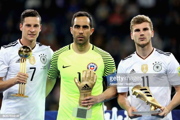Julian Draxler of Germany Claudio Bravo of Chile and Timo Werner of Germany all pose with their awards after the FIFA Confederations Cup Russia 2017...