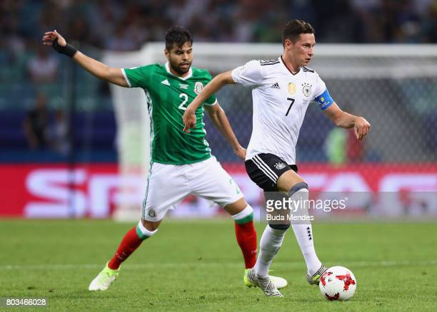 Julian Draxler of Germany controls the ball under pressure of Nestor Araujo of Mexico during the FIFA Confederations Cup Russia 2017 SemiFinal...