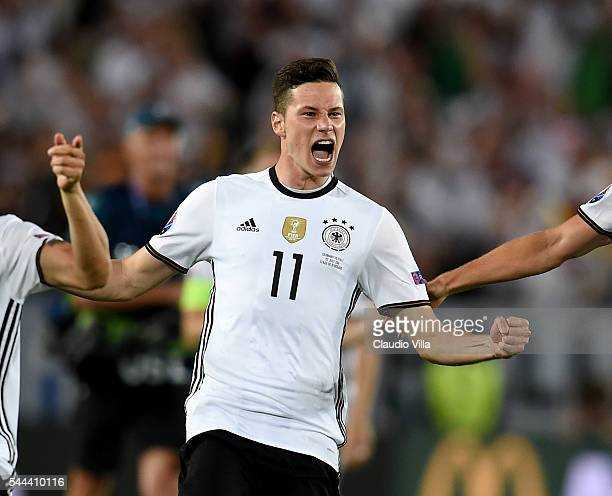 Julian Draxler of Germany dash to celebrates their win through the penalty shootout after Jonas Hector scores to win the game after the UEFA EURO...