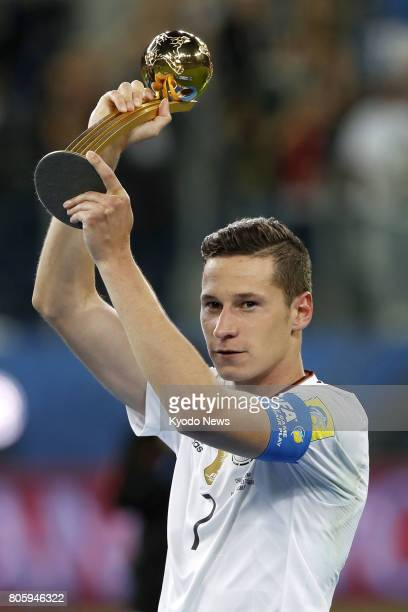 Julian Draxler of Germany holds the Golden Ball trophy for the Confederations Cup's best player in St Petersburg on July 2 2017 Germany beat Chile 10...