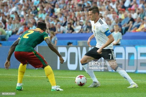 Julian Draxler of Germany in action against Ernest Mabouka of Cameroon during the FIFA Confederations Cup 2017 soccer match between Cameroon and...