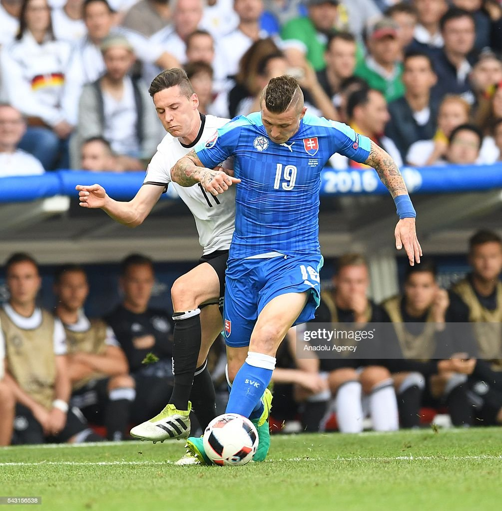 Julian Draxler (L) of Germany in action against Juraj Kucka (R) of Slovakia during the UEFA Euro 2016 round of 16 football match between Germany and Slovakia at Stade Pierre Mauroy in Lille, France on June 26, 2016.