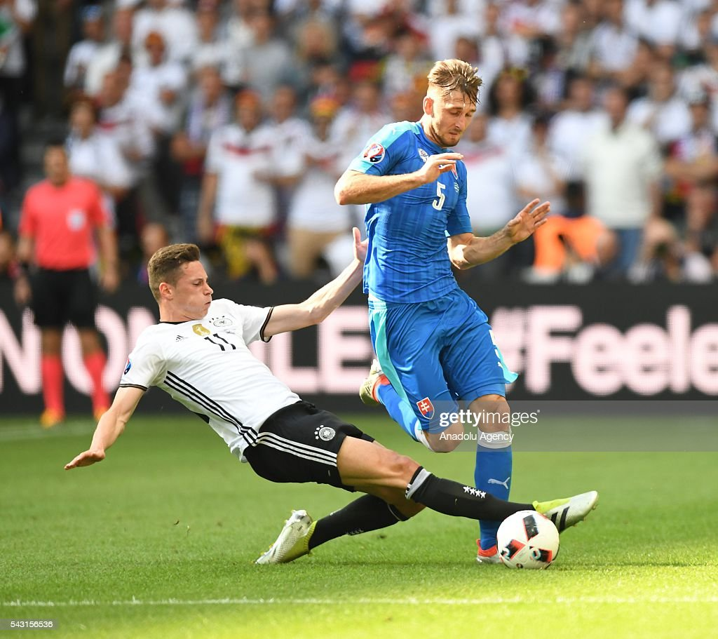 Julian Draxler (L) of Germany in action against Norbert Gyomber (R) of Slovakia during the UEFA Euro 2016 round of 16 football match between Germany and Slovakia at Stade Pierre Mauroy in Lille, France on June 26, 2016.