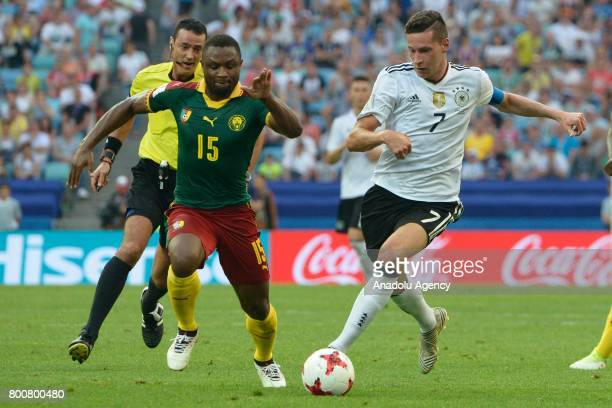 Julian Draxler of Germany in action against Sebastien Siani of Cameroon during the FIFA Confederations Cup 2017 soccer match between Cameroon and...