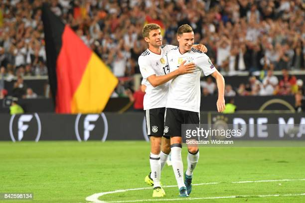 Julian Draxler of Germany is celebrated by Thomas Mueller of Germany after he scored to make it 20 during the FIFA 2018 World Cup Qualifier between...