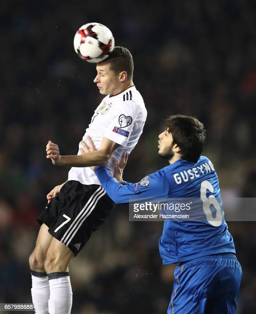 Julian Draxler of Germany is challenged by Badavi Hseynov of Azerbaijan during the FIFA 2018 World Cup Qualifing Group C between Azerbaijan and...