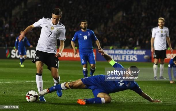Julian Draxler of Germany is challenged by Rashad F Sadygov of Azerbaijan during the FIFA 2018 World Cup Qualifiying group C match between Azerbaijan...