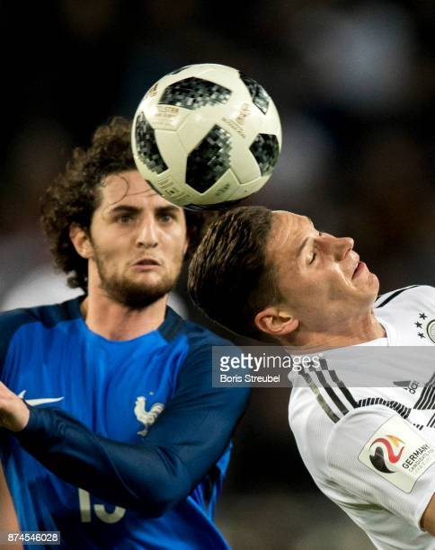 Julian Draxler of Germany jumps for a header with Adrien Rabiot of France during the International friendly match between Germany and France at...