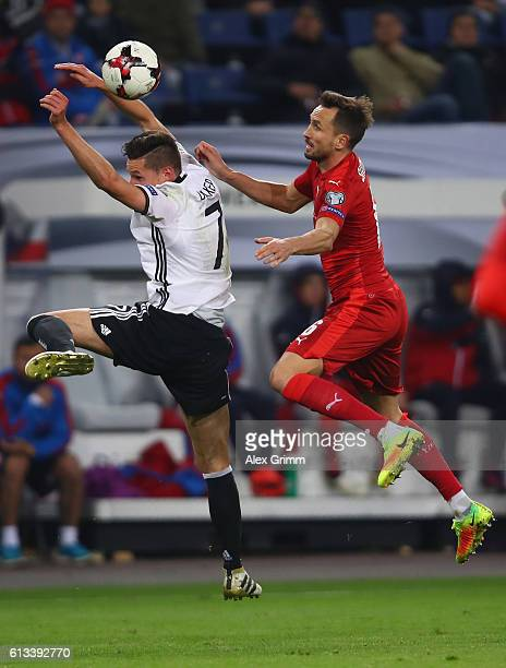 Julian Draxler of Germany jumps for a header with Tomas Sivok of Czech Republic during the FIFA World Cup 2018 qualifying match between Germany and...